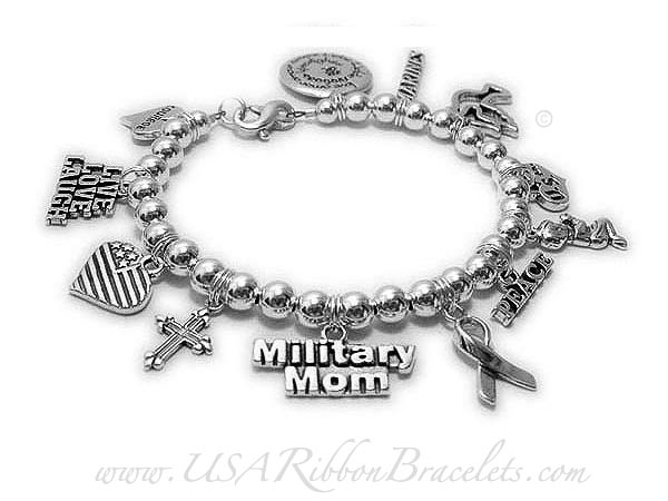 Military Mom Charm Bracelet  Shown with 12 add-on charms. Starting at $10/each  Love in Many Languages, Marines, Peace Dove, USA, Boy Praying, PEACE, Silver Ribbon Charm, Military Mom charm, Fancy Cross Charm, Flag Heart Charm, LIVE LOVE LAUGH charm, COURAGE charm.