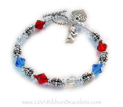 The Red White and Blue Crystal Charm Bracelet is shown with 2 add-on charms: Praying Boy and a Heart Flag charm. They picked one of my beautiful free Twisted Toggle Clasps.